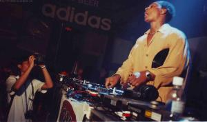 The Detroit innovator Derrick May gracing the decks at Consortium. Check out the Adidas banner. Yup, my favorite brand supporting COnsortium back then.Photo by Eddie Boy Escudero.
